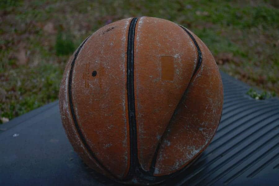 Photo of an old deflated basketball.