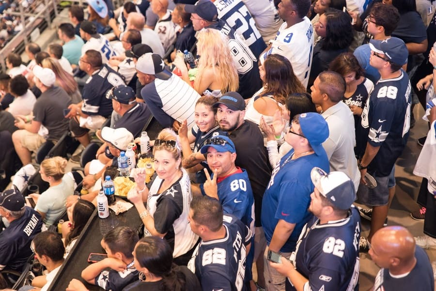 Photograph of Giants fans in with some Dallas football fans.