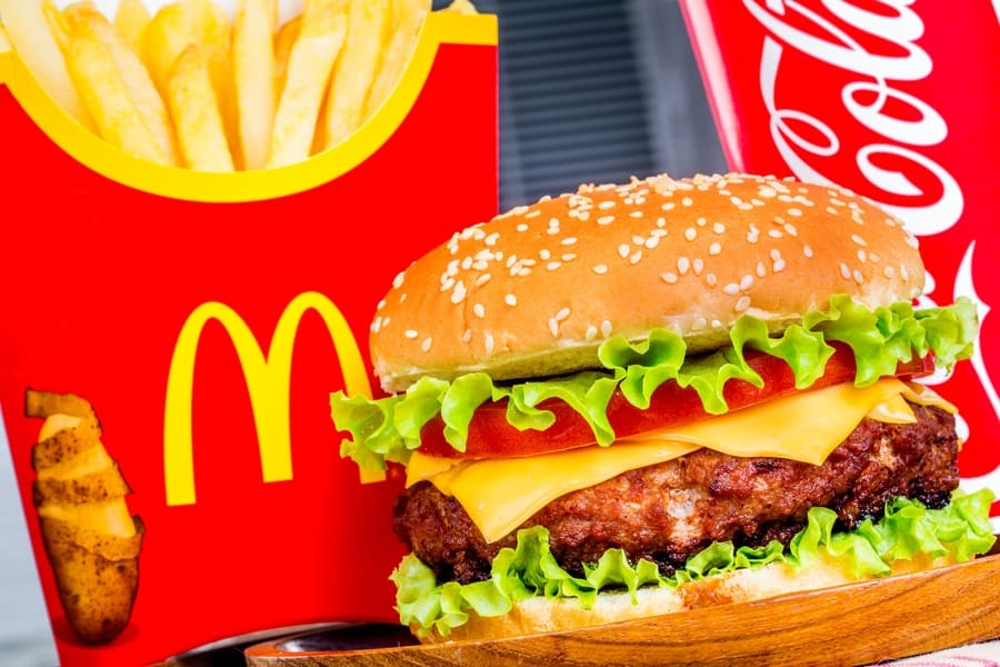Photograph of a McDonald's meal with a large cheeseburger in the center.