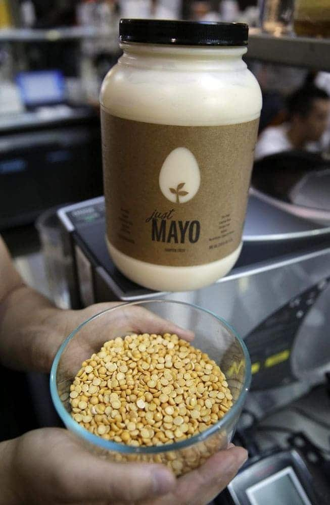 Photograph of Hampton Creek Founder, Josh Tetrick's hands holding a bowl of yellow peas used to make Just Mayo.
