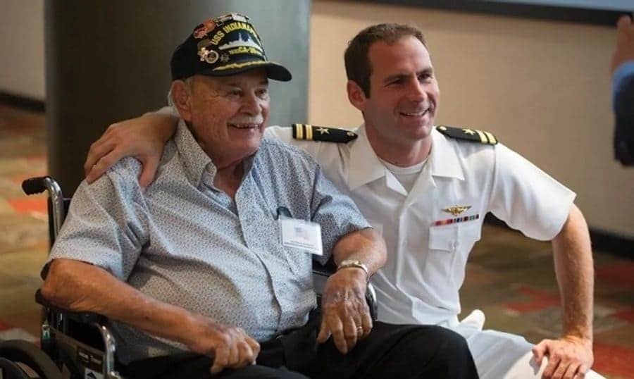 Lieutenant Hunter Scott with a survivor of the Indianapolis.