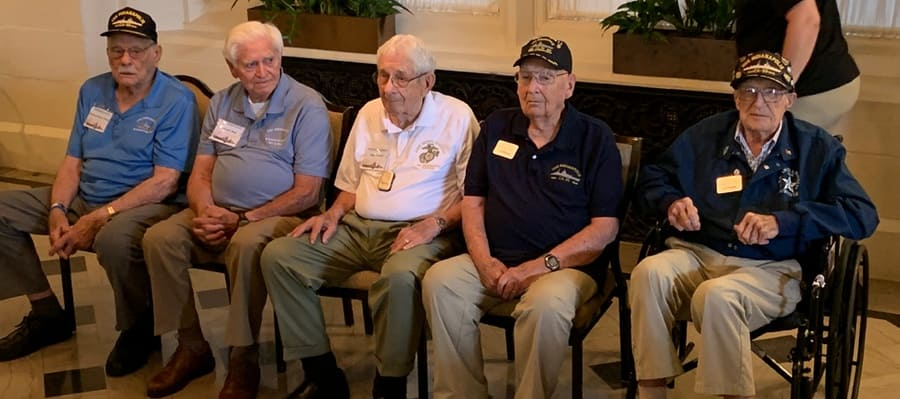 Five of the 12 remaining survivors of the sinking of the U.S.S. Indianapolis