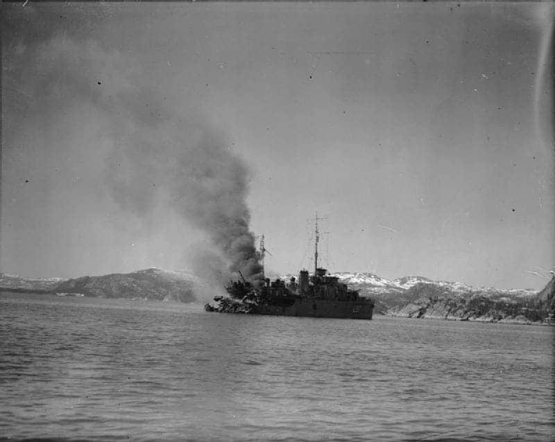HMS BITTERN ablaze in Namsos Fjord after having suffered a direct hit in the stern by a bomb.