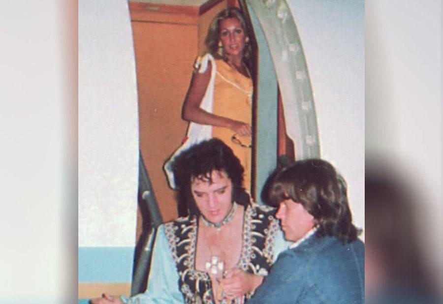 Elvis Presley with Linda Thompson near an airplane