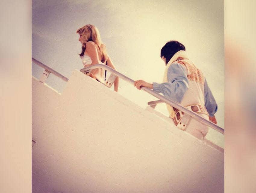 Elvis Presley with Linda Thompson boarding the Lisa Marie