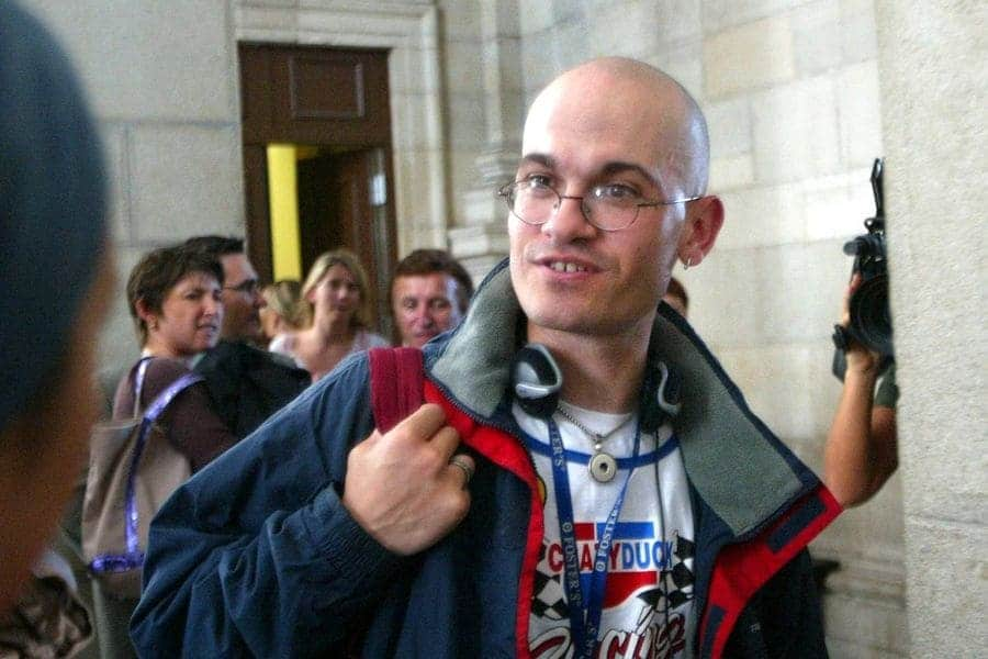 Frederic Bourdin with a completely shaved head outside of the courthouse answering questions on September 15th, 2005.