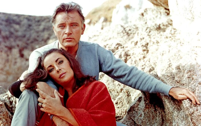 """Elizabeth Taylor and Richard Burton on the film set of """"The Sandpiper"""" in 1965"""