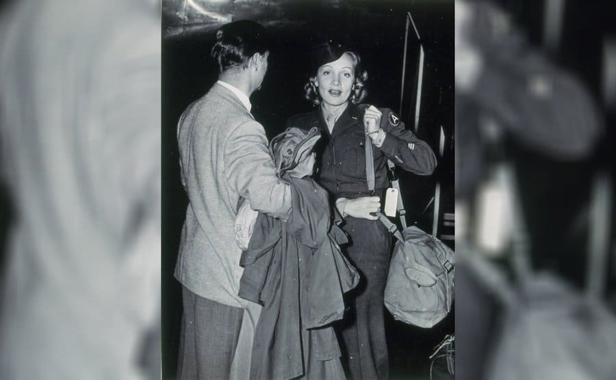 Marlene Dietrich with her husband returning from a USO tour, 1945.