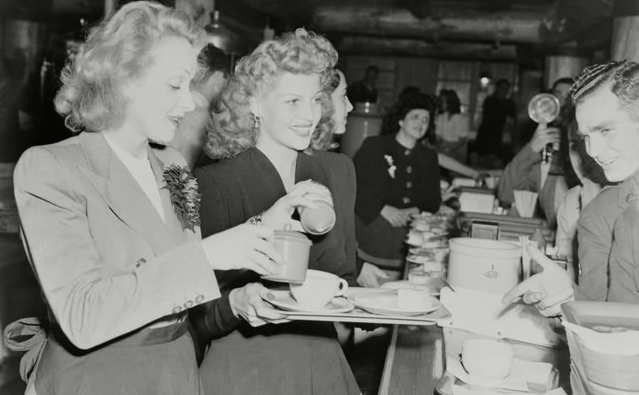 Marlene Dietrich and Rita Hayworth serving soldiers at the Hollywood Canteen during WWII, November 17, 1942.
