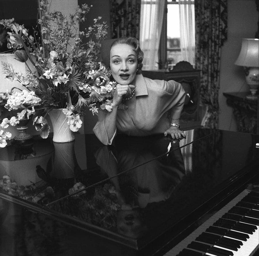 Marlene Dietrich leaning on the piano, May 1955