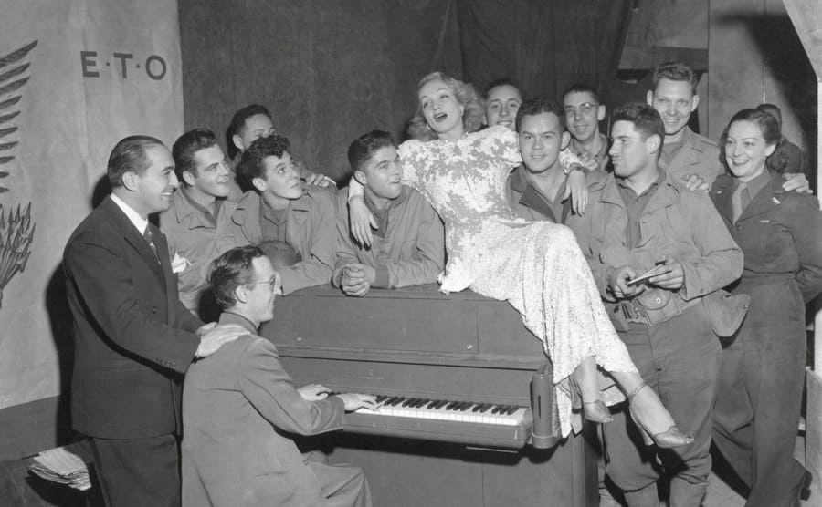 Marlene Dietrich singing for a group of GLS in France with Jerry Cummings on the Piano.