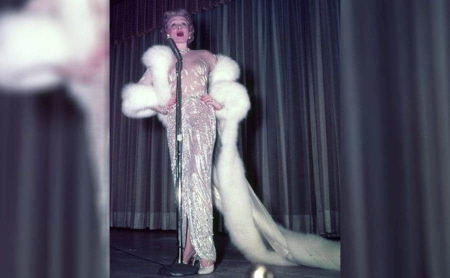 Marlene Dietrich in her dress filled with crystals and a fur shawl, 1953.