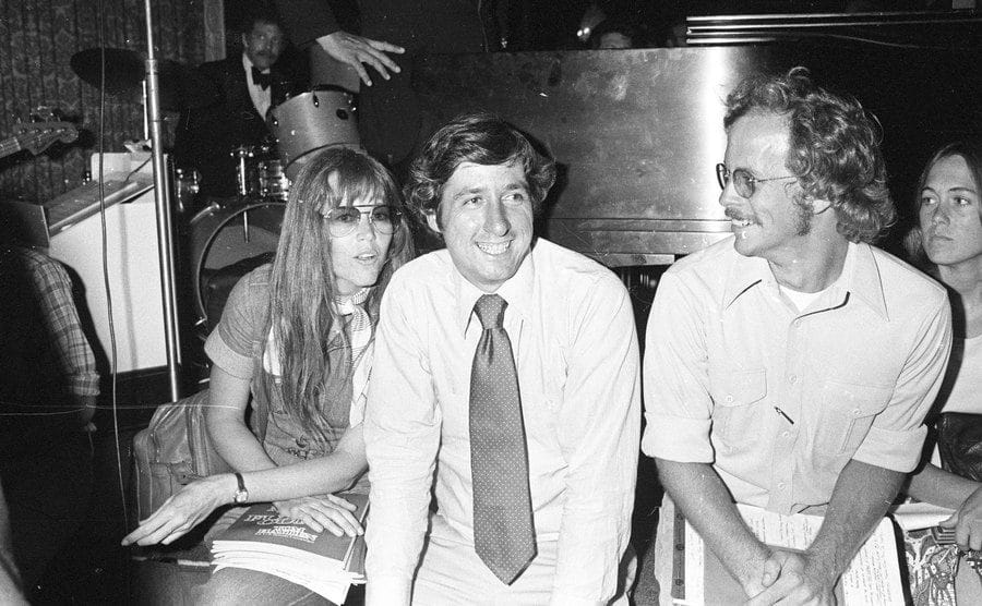 Jane Fonda with activist Tom Hayden and another man at an NYC Democratic Committee fundraiser.