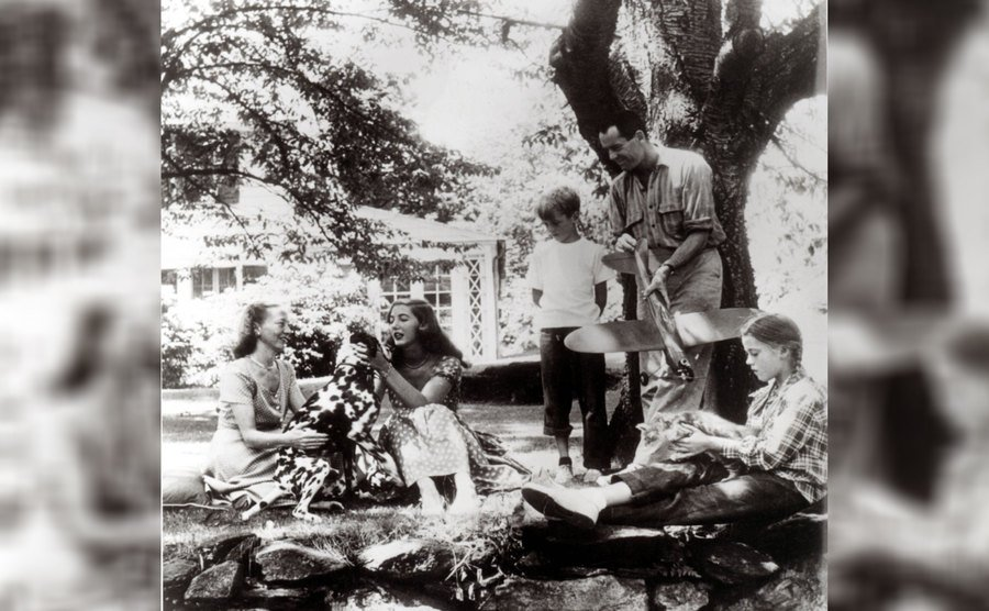 Henry, Peter, Jane, and Frances Fonda with their Dalmation hanging out in their front yard.