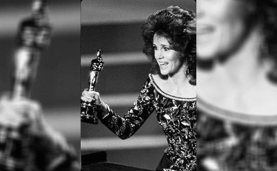 Jane Fonda was holding her Oscar on stage for the film 'Coming Home.'