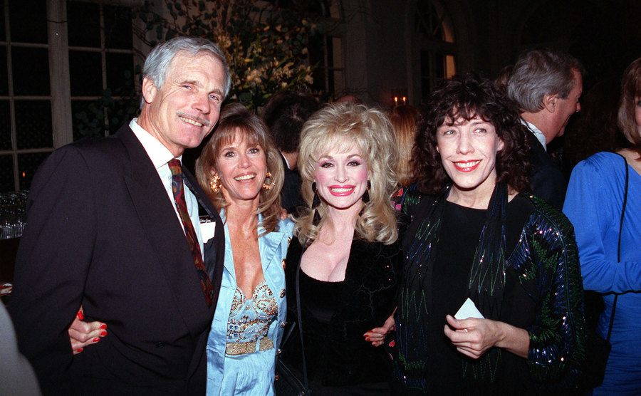 Ted Turner, Jane Fonda, Dolly Parton, and Lily Tomlin at a wedding reception together in January 1992.