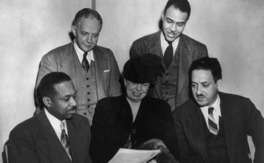 Thurgood Marshall sitting with Eleanor Roosevelt, James McClendon, Walter White, and Roy Wilkins.