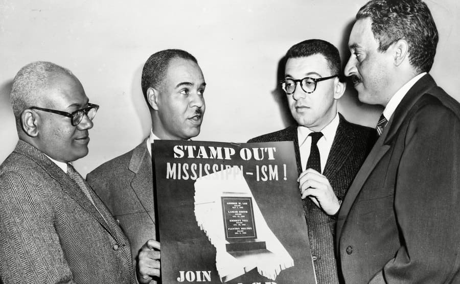 NAACP leaders in 1956, Henry L Moon, Roy Wilkins, Herbert Hill, and Thurgood Marshall.