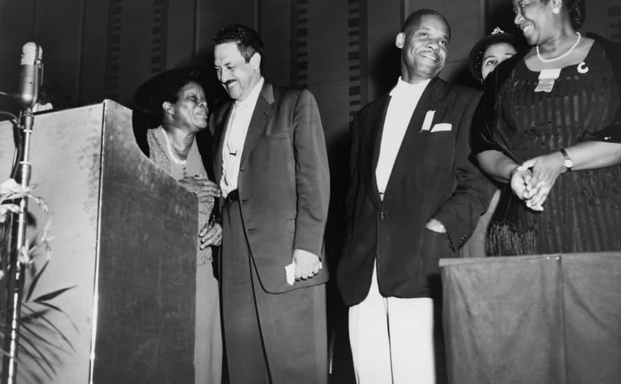 Thurgood Marshall standing with educator Nannie Helen Burroughs circa 1950.