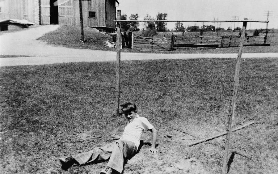 James Dean fooling around in the yard as a kid