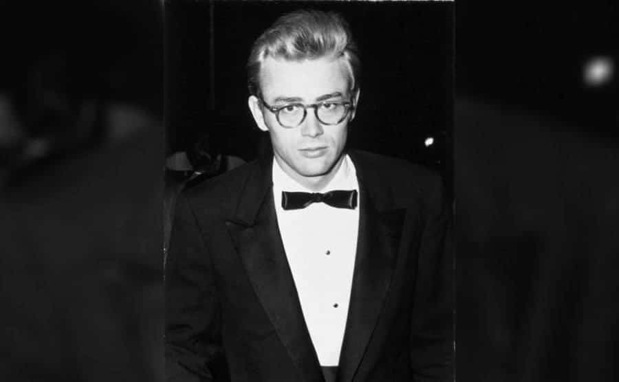 James Dean wearing glasses and a tuxedo