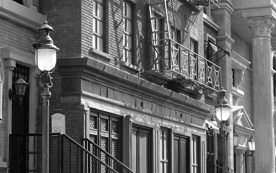 A black and white photo of homes on a street