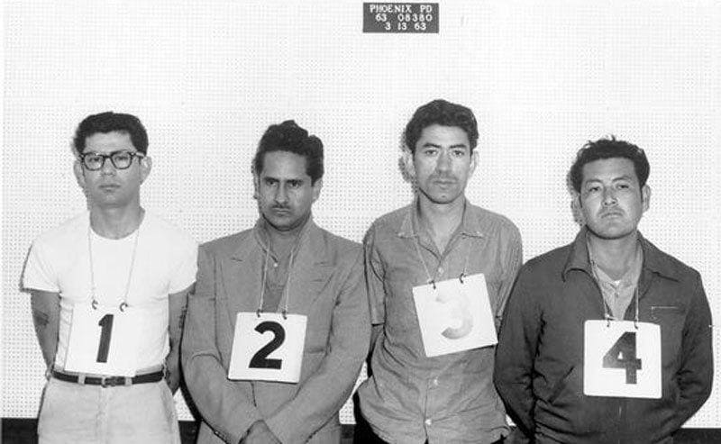 The lineup of four guys, Ernesto Miranda, wearing a number 1 sign.