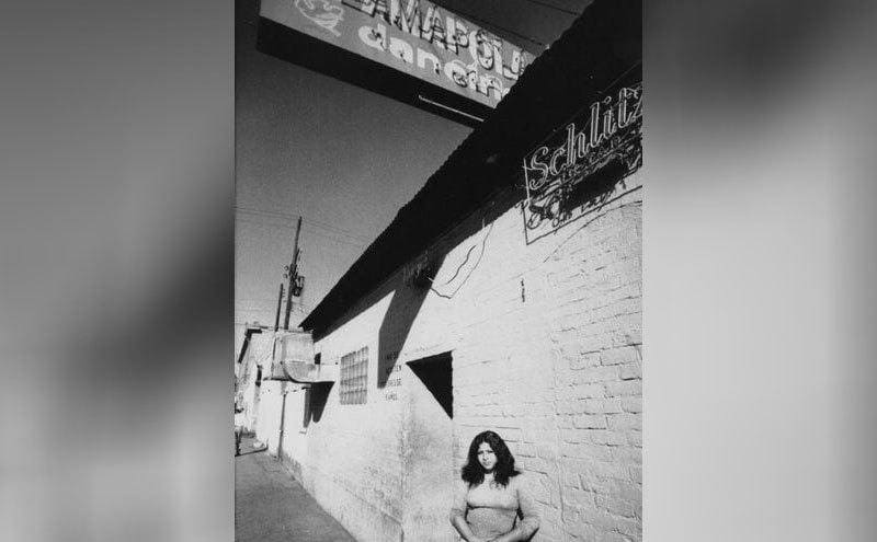 A woman standing outside of the bar where Ernesto Miranda was killed.