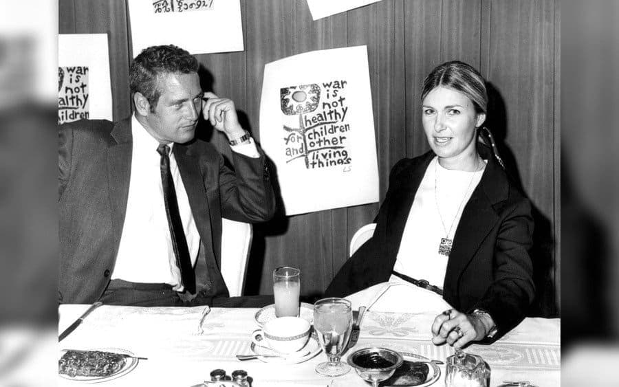 Paul Newman with Joanne Woodward Sitting at Dining Table