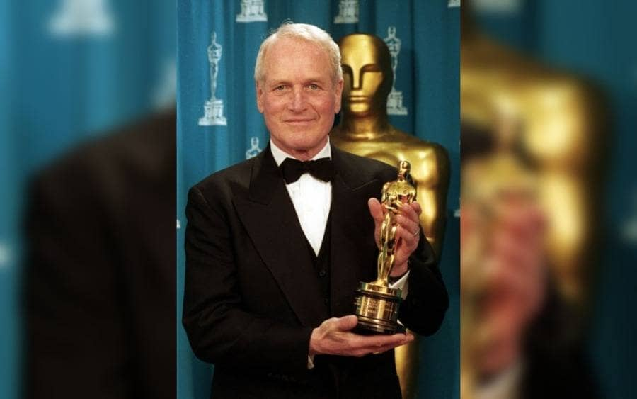 actor Paul Newman holds the Oscar he received for the Jean Hersholt Humanitarian Award in Los Angeles.