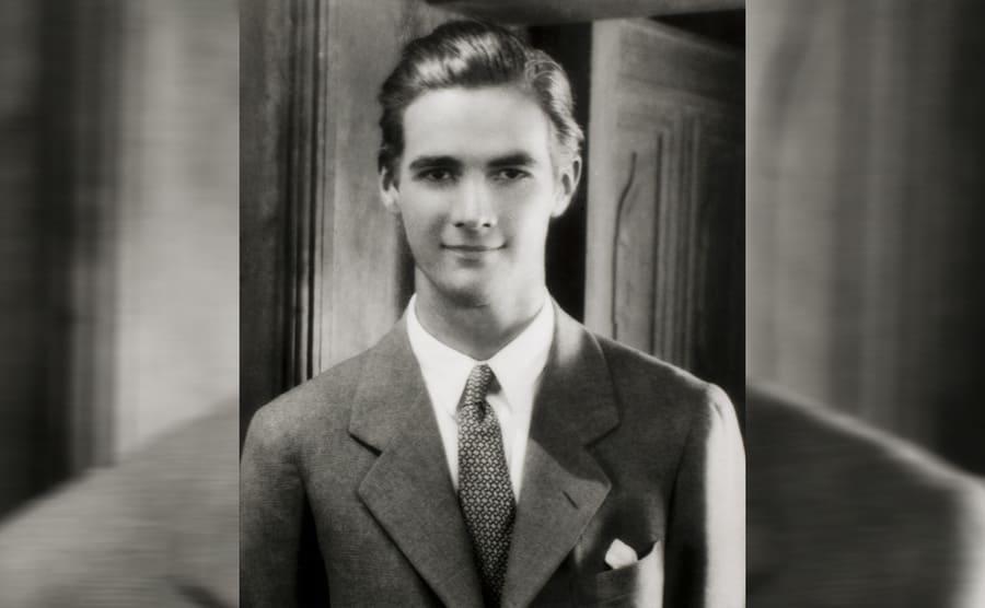 Howard Hughes posing in a suit
