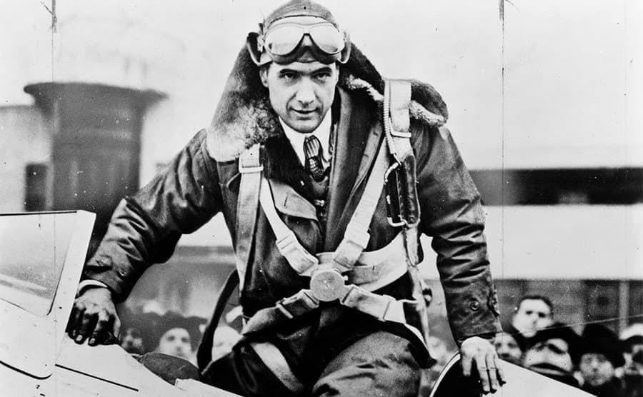 Howard Hughes geared up coming out of the cockpit of an airplane circa 1935