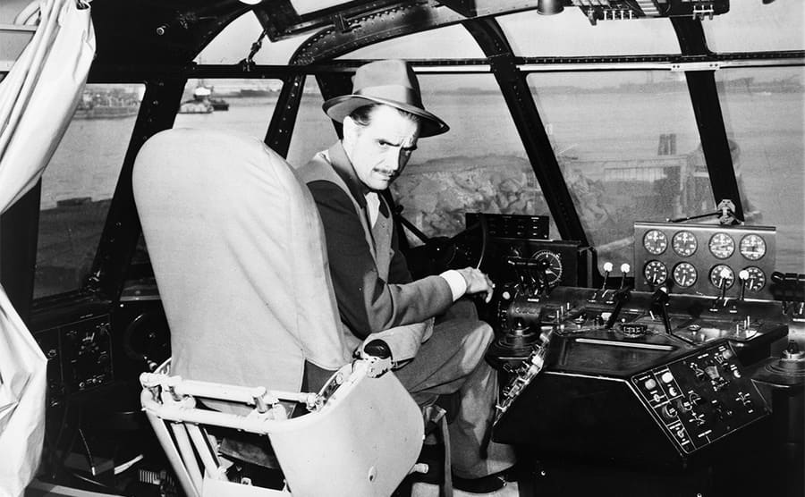Howard Hughes in the cockpit of an old wooden flying boat
