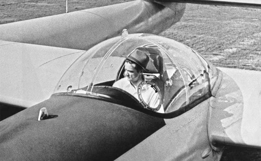 Howard Hughes sitting in the cockpit of the plane which later crashed