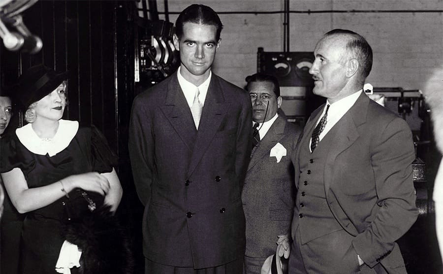Howard Hughes, Donald Crisp, and others standing around