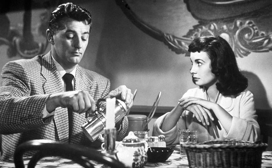 Robert Mitchum and Jean Simmons drinking coffee at a restaurant in Angel Face