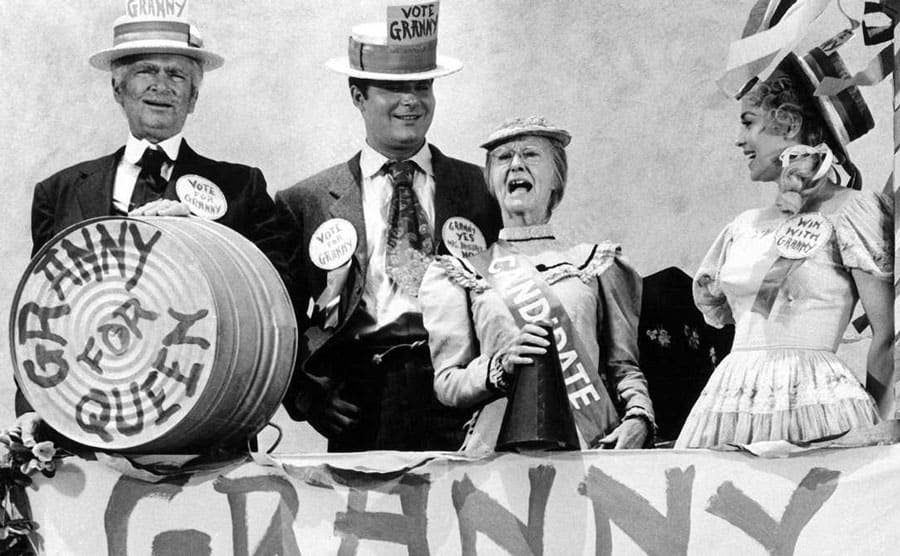 Buddy Ebsen, Max Baer Jr, Irene Ryan, and Donna Douglas with signs and hats for Granny for Queen