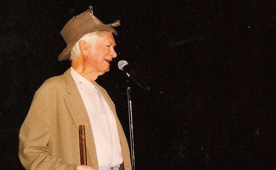 Buddy Ebsen on stage with an instrument