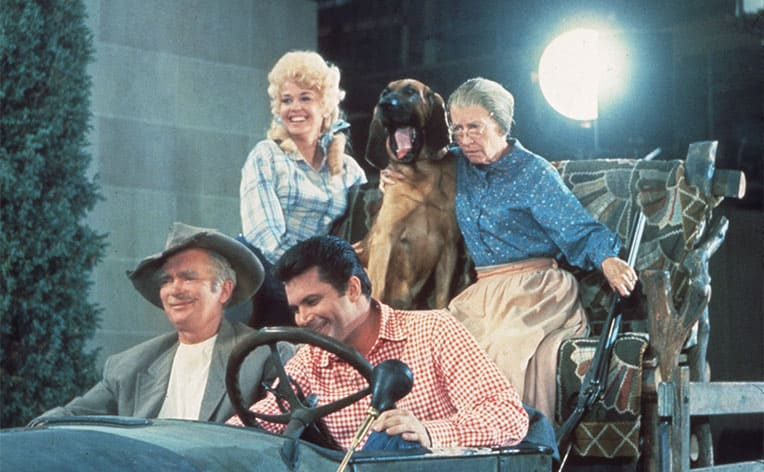 Everyone inside of the old car for the opening scene of The Beverly Hillbillies without the backdrop in the scene