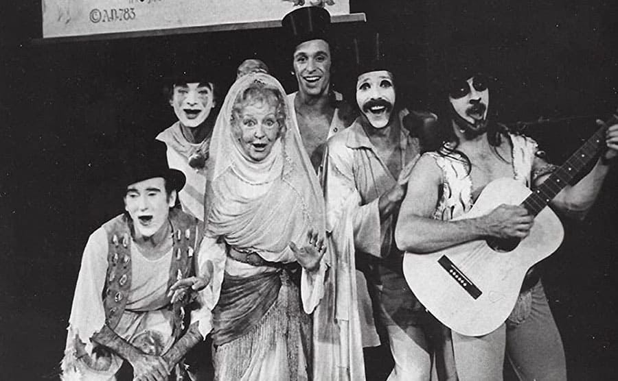 Irene Ryan in the front and center of a photograph with members of the musical Pippin circa 1972