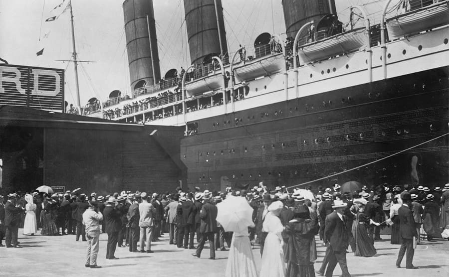Passengers waiting outside of the Lusitania to board