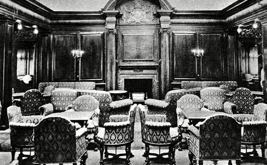 The smoking room of the Lusitania with large chairs surrounding smaller tables