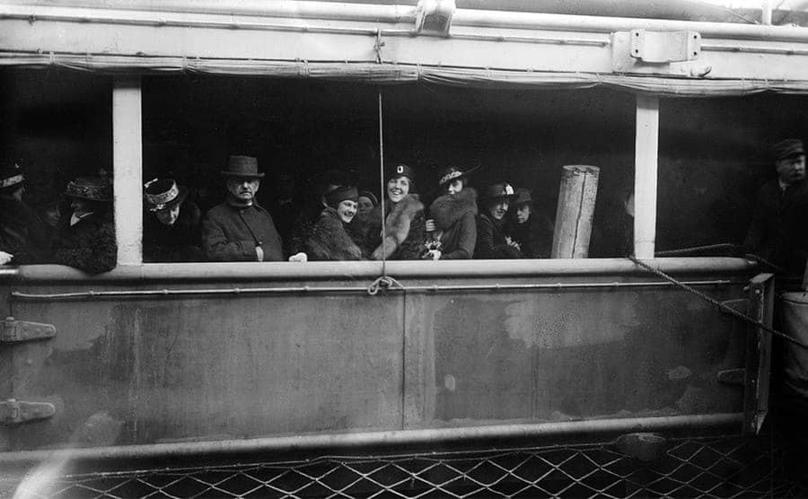 Passengers outside on the deck of a ship