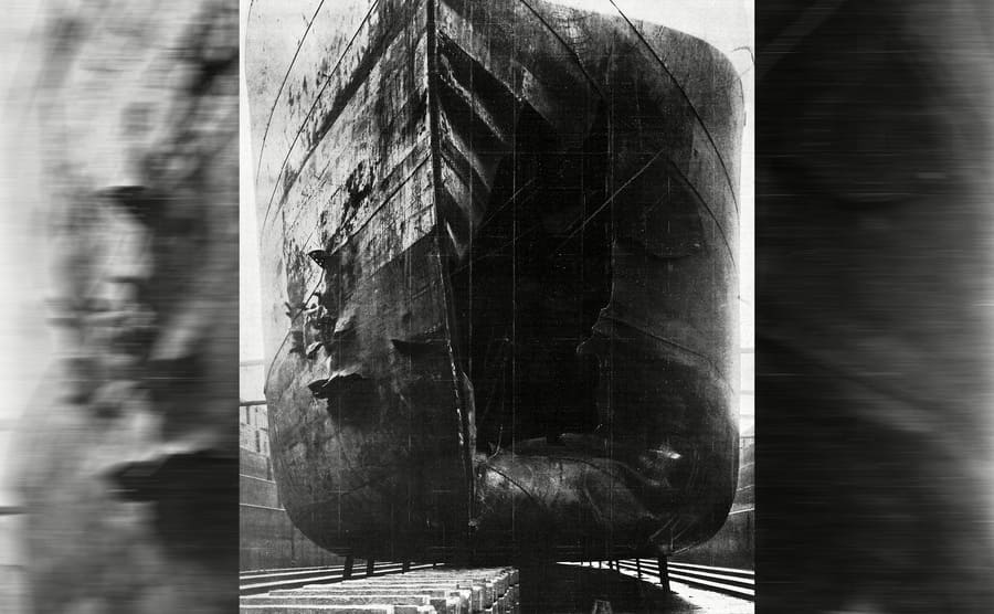 The front of a ship with a large hole