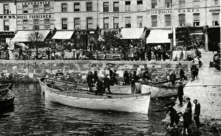 Five lifeboats carrying survivors from the Lusitania in Queenstown Harbor