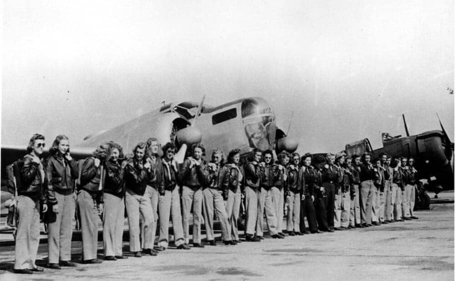 Female pilots lined up on the tarmac