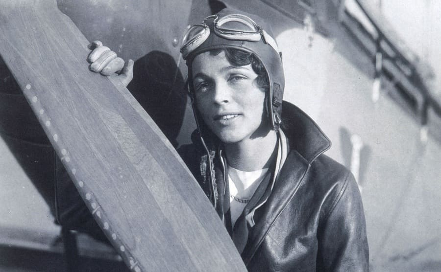 Betty Gillies standing in front of her plane