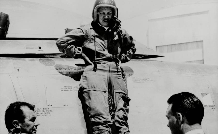 Jacqueline Cochran standing next to her plane with Chuck Yeager and Bill Longhurst at the Edwards Air Force Base in California