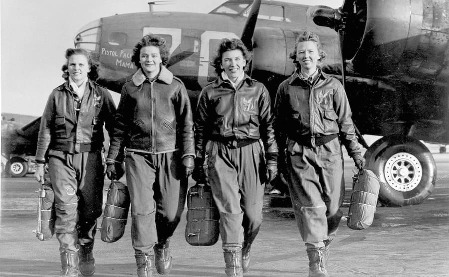 Four female pilots walking away from their planes