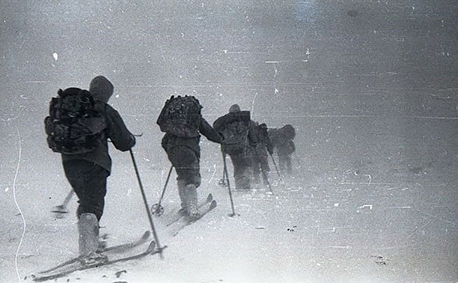 The hikers disappearing into the snow